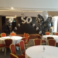 Medium arch with large numbers incorporated at Hilton Glasgow